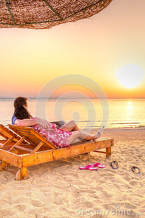 Couple in hug watching together sunrise over Red Sea
