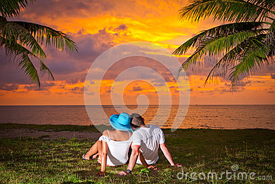 Couple in hug watching together sunset