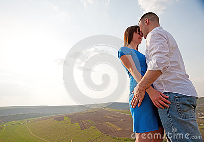 Couple hugging in countryside