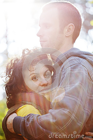 Free Couple Hugging Each Other In Sunlight Royalty Free Stock Image - 35354376