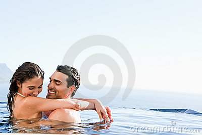 Couple hugging in the pool