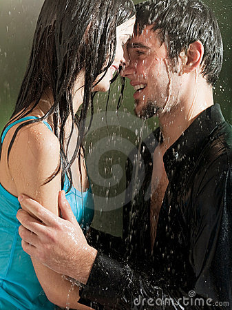 Couple hugging under a rain