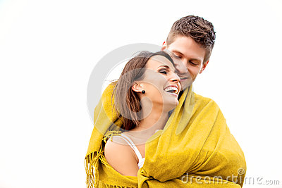 Couple Hugging While Wrapped in Blanket