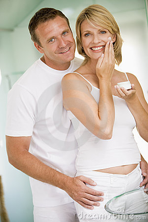 Free Couple In Bathroom With Face Cream Royalty Free Stock Photo - 5930575