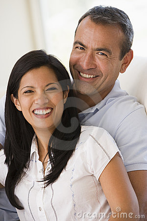 Free Couple In Living Room Smiling Stock Photos - 5931483