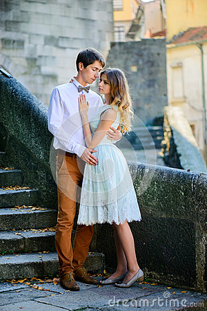 Free Couple In Love Strolling Around An Old Castle Stock Photos - 64975613