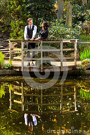 Free Couple In Victorian Fashion Near Lake With Reflections  In Park Royalty Free Stock Images - 39780419