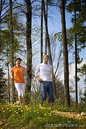 Couple jogging in forest