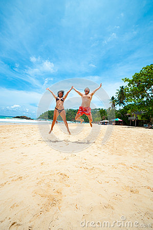 Couple jumping on a beach