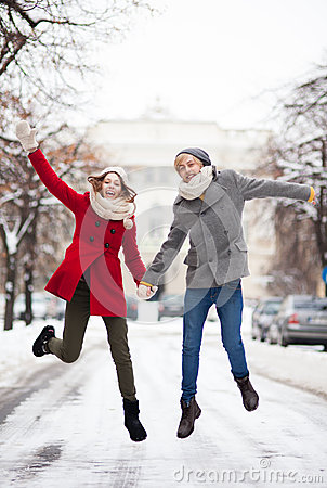 Couple Jumping In Snow Royalty Free Stock Photography - Image: 29466097