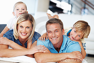 Couple with kids relaxing at home