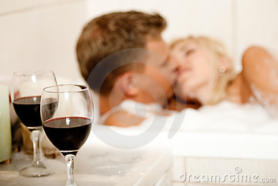 Couple kissing in the bath