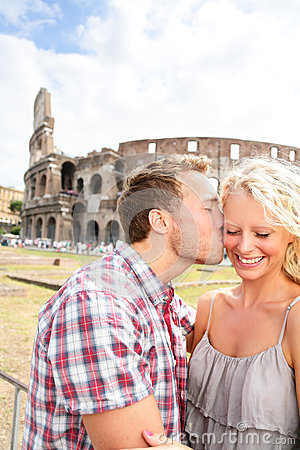 Couple kissing in love in Rome by the Colosseum