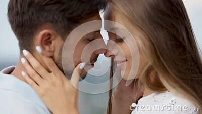 Couple Kissing Outdoors Closeup stock footage