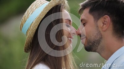 Couple Kissing Outdoors Closeup stock video