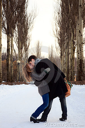 Couple kissing in the poplar alley