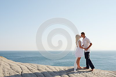 Couple kissing by the sea