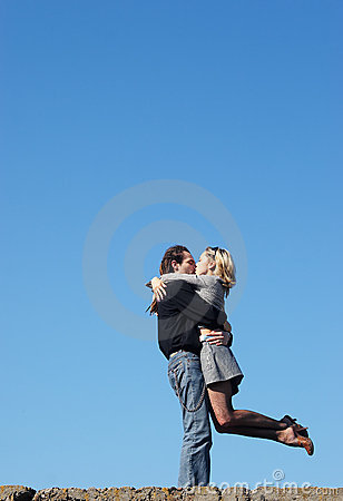 Couple kissing under the sky