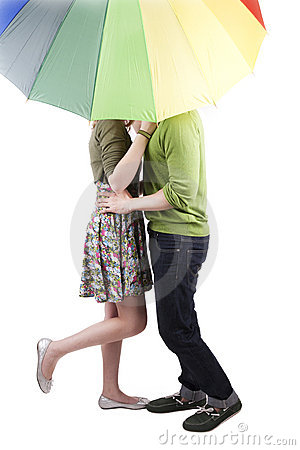 Couple kissing under the umbrella