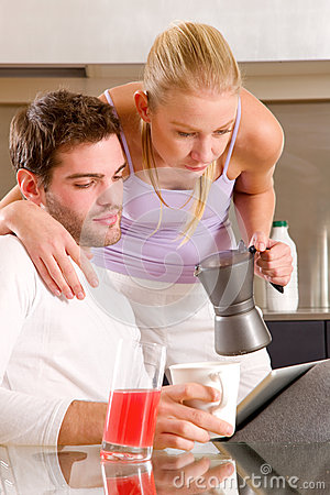 Couple in kitchen having breakfast