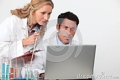 Couple in laboratory