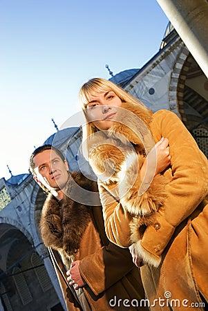 Couple in lambskin coats