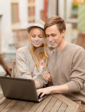 Couple with laptop in cafe