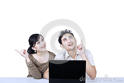 Couple with laptop looking up isolated
