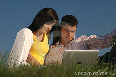 Couple with laptop in nature