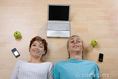 Couple With Laptop And Phones Royalty Free Stock Photography - Image: 11649147