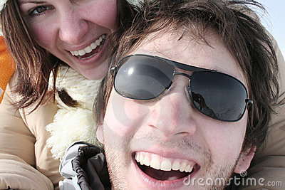 Couple laughing looking at the camera