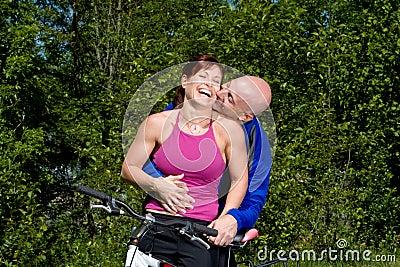 Couple Laughing Next to Bike - Horizontal