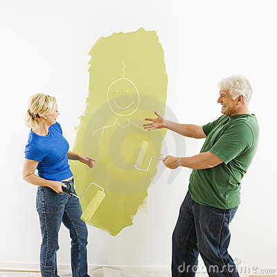 Couple laughing at smiley face painting.