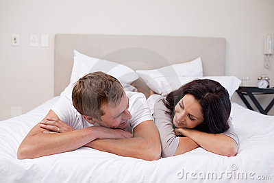 couple laying on the bed looking at each other stock photo image 22348210. Black Bedroom Furniture Sets. Home Design Ideas