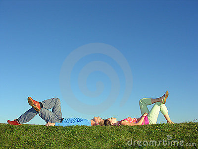 Couple lie on blue sky