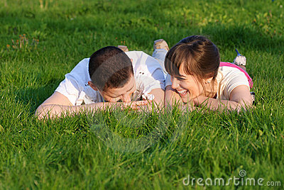 Couple lie on the grass