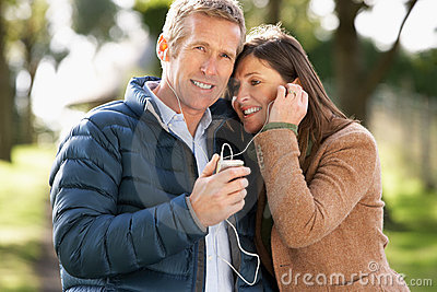 Couple Listening To MP3 Whilst Walking