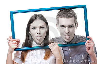Couple look from frame with stick out tongue