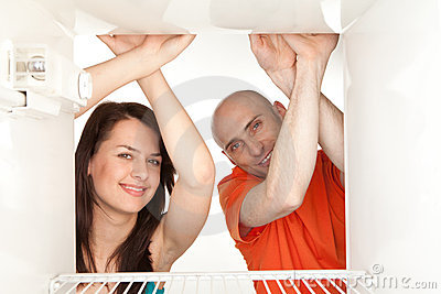 Couple looking in empty fridge