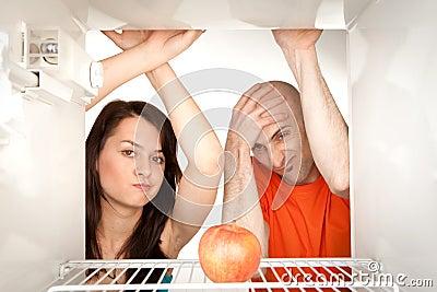 Couple looking in fridge