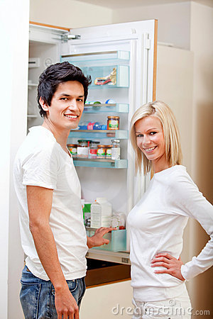 Couple looking inside the fridge