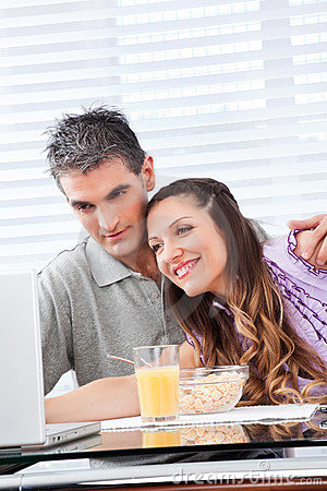Couple looking at laptop at