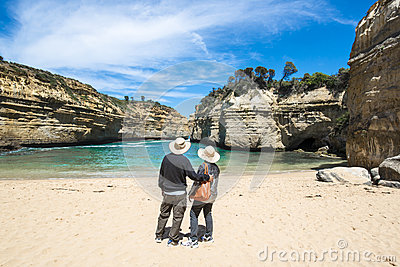 Couple looking through the Rocks to Ocean Editorial Photography