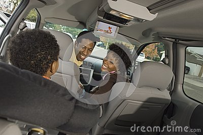 Couple Looking At Small Boy In Car