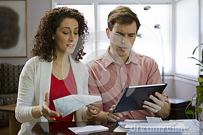 Couple looking at tablet, horizontal