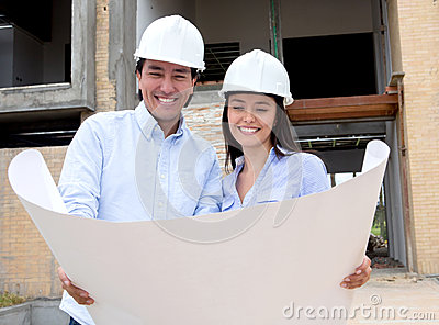 Couple looking at their house design