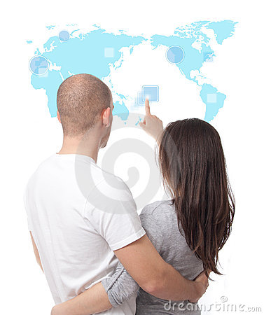 Couple looking at a touch screen world map
