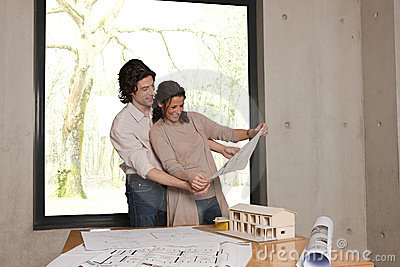 Couple looks at plans