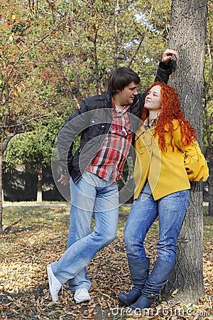 Couple in love in autumn park