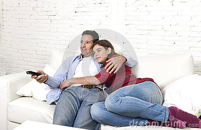 https://thumbs.dreamstime.com/x/couple-love-cuddling-home-couch-relaxing-watching-movie-television-man-holding-remote-control-young-attractive-61343126.jpg